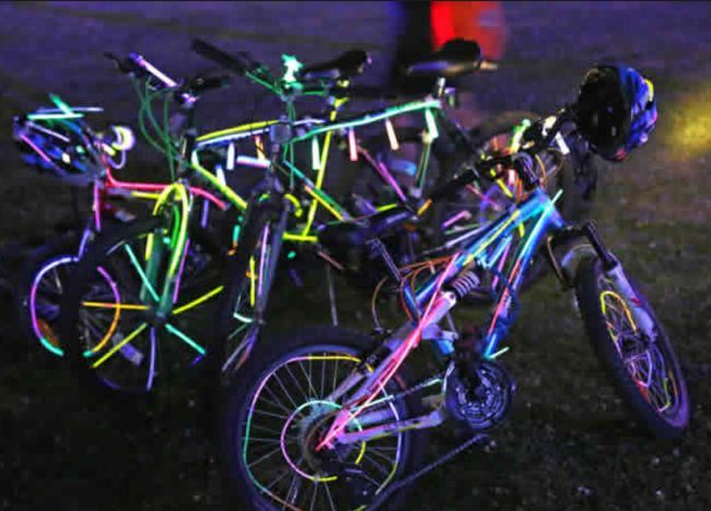 glowing bicycles at night