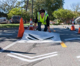 Painting bike lane arrows on the road