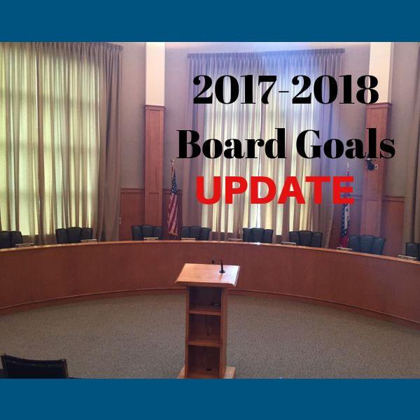 Board room picture with 2017-2018 goals update captioned