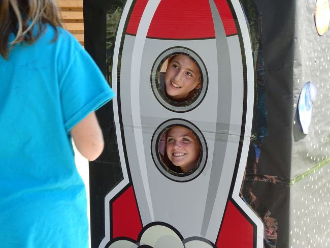 Rocket photo prop with children sticking their faces through