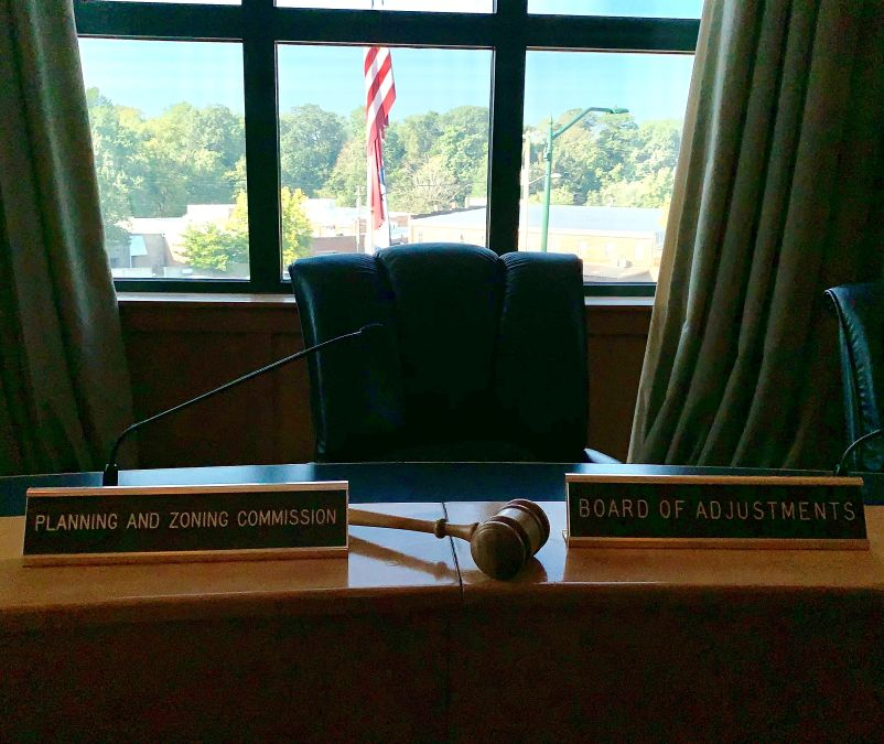 Board room with P&Z name plates and gavel 1