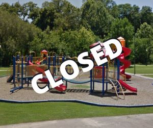 "Playground equipment with word ""closed"" over it"