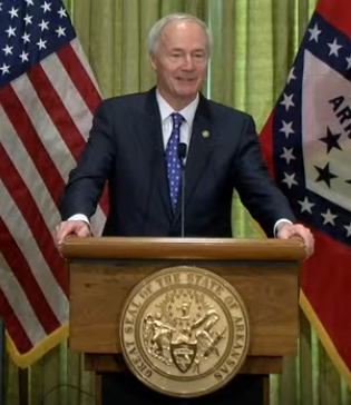 Governor Hutchinson standing at a podium