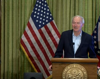 Governor Hutchinson standing at podium