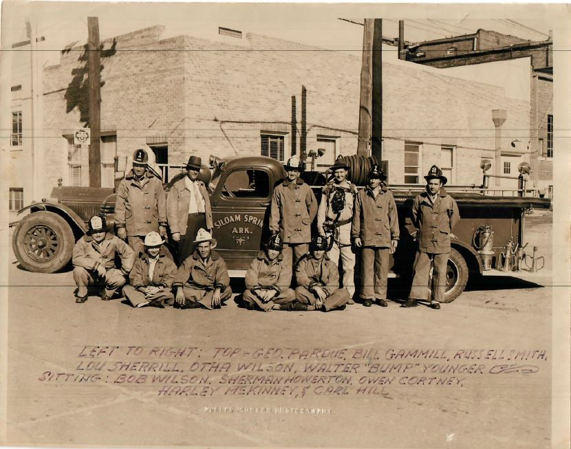 SSFD photo of fire trucks and firefighters approximately 1950